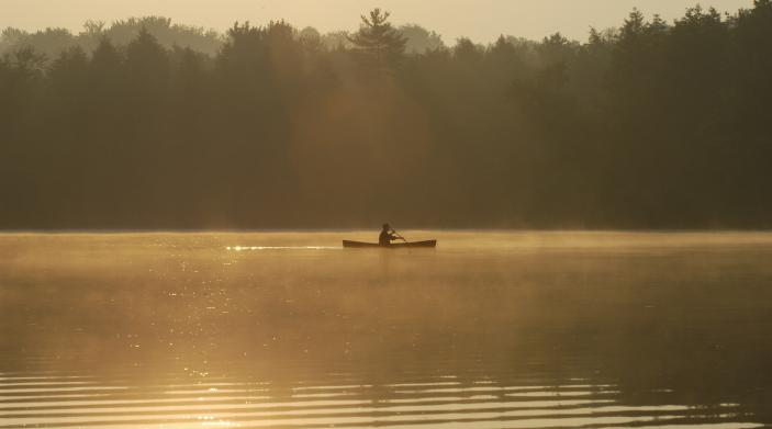 waterfont land for sale example with silhouette of canoe